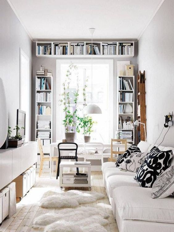 prints are added to this neutral space with monochromatic yet patterned pillows on the sofa