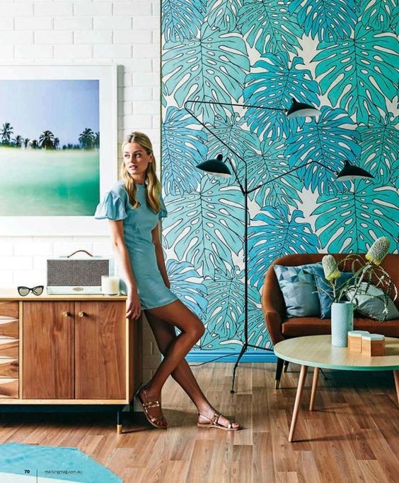 a bright monstera leaf statement wall is amazing for sprucing up the space and making it bold