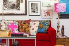 11 a colorful and bright living room with super bold artworks covering the whole wall