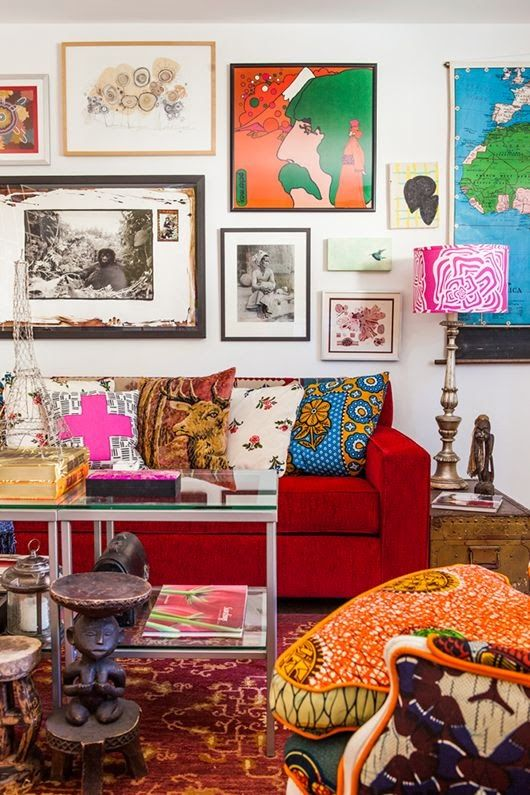 a colorful and bright living room with super bold artworks covering the whole wall