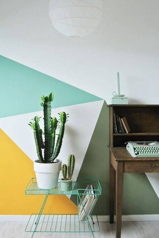 a home office spruced up with green, emerald, yellow and white and a geometric look