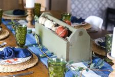 11 a simple and rustic Thanksgiving setting with a bold blu runner and napkins plus green glasses