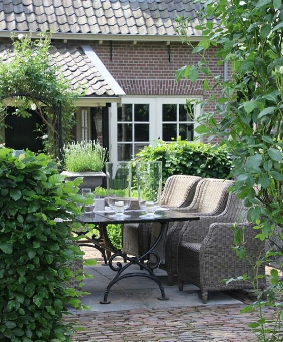 create an outdoor dining space with wicker furniture in your back patio to extend the living space and enjoy fresh air