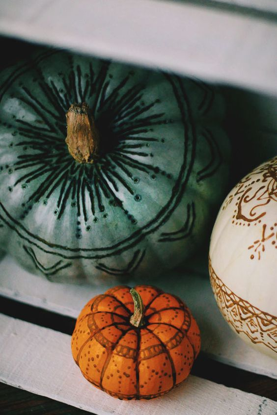 henna and wood burnt pumpkins are a cool and unusual idea for a boho chic Halloween