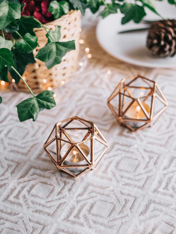 such geometric copper candle holders are a nice idea for any season and holiday, they never go out of style