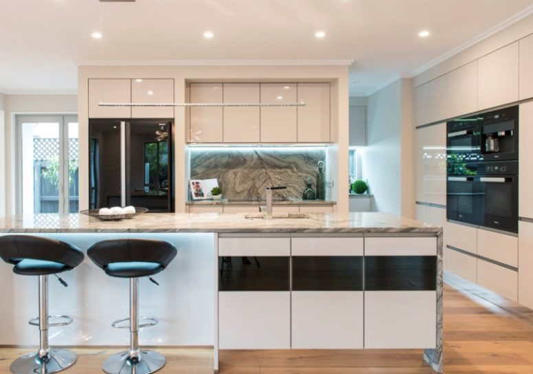 try a black glass door fridge to add a contemporary feel to your minimalist kitchen and create a contrast