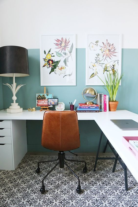 a light green color blocked wall makes the space cooler and bolder adding a modern feel to it