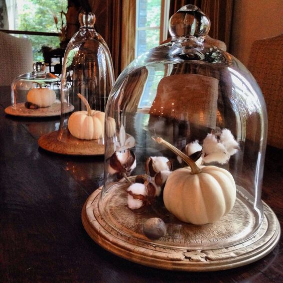 a rustic display with a vintage bread board, cotton branches and a white pumpkin won't take much time to make
