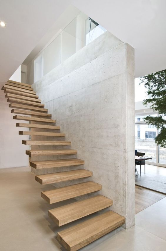 attaching the steps to the wall gives them really a floating and seamless look and concrete contrasts wood