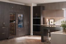 integrate your fridge and wine cooler into your wooden cabinets to keep the kitchen more unified and sleek