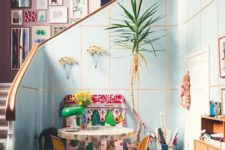 13 a colorful space and a pink wall that is completely covered with bright artworks for a bold touch