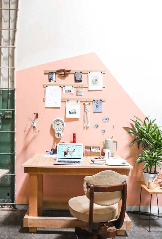 a modern home office and crafting space with a geometric color block wall in pink for a cute look