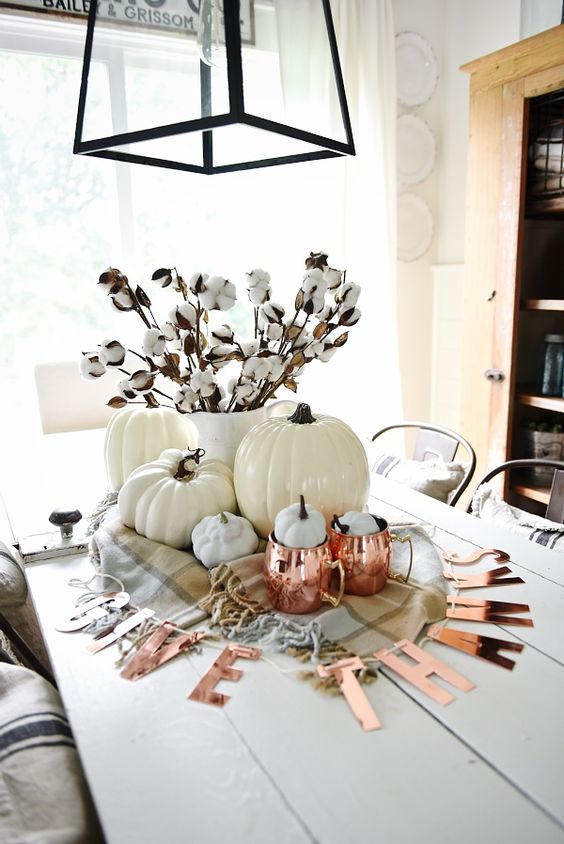 copper letter banner and copper mugs dress up a white pumpkin centerpiece and add color to it