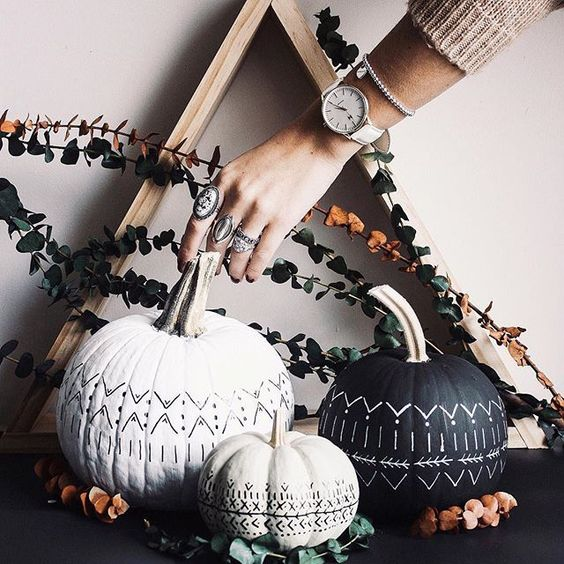 gorgeous boho-inspired black and white pumpkins and a wooden frame plus eucalyptus