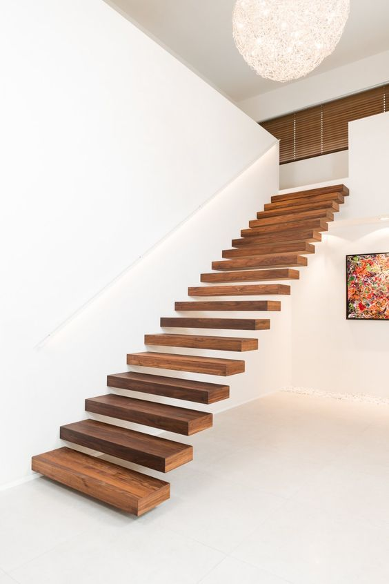 the secret of seamless staircases is attaching them to walls or railings to make them look ethereal