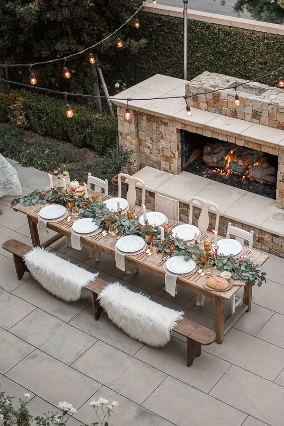 a fireplace and faux fur throws on the benches willmake sitting cozier and much warmer