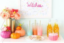 15 a colorful Halloween drink bar with bright pumpkins, ombre glasses and a sprinkle sign, a lush floral centerpiece
