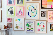 15 a colorful modern gallery wall with decorative plates,colorful frames and neon touches