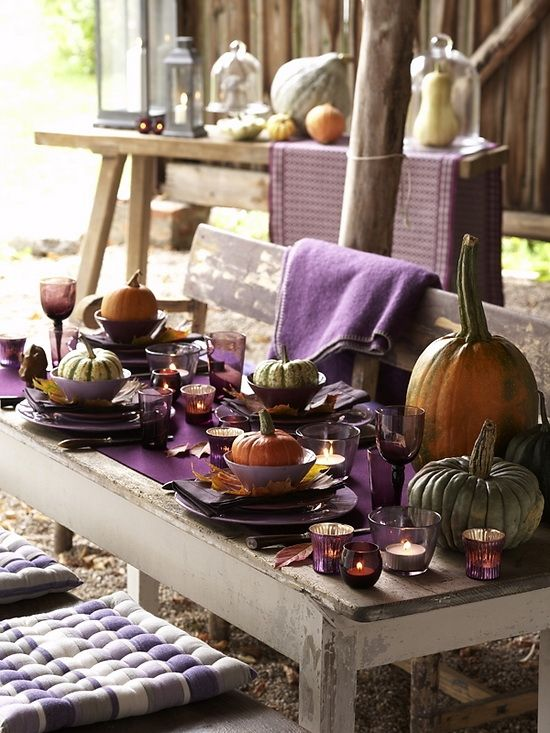 purple as the main jewel tone, for the table runner, napkins, glasses and candle holders and heirloom pumpkins