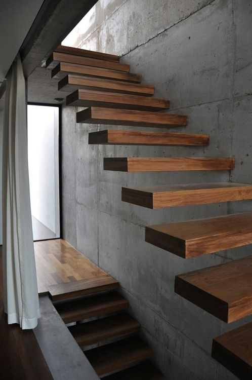 this floating staircase looks really ethereal, as if it's floatign in the air