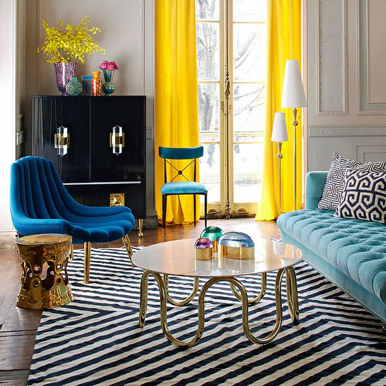 a dramatic chevron rug in black and white plus printed pillows that add interest, too