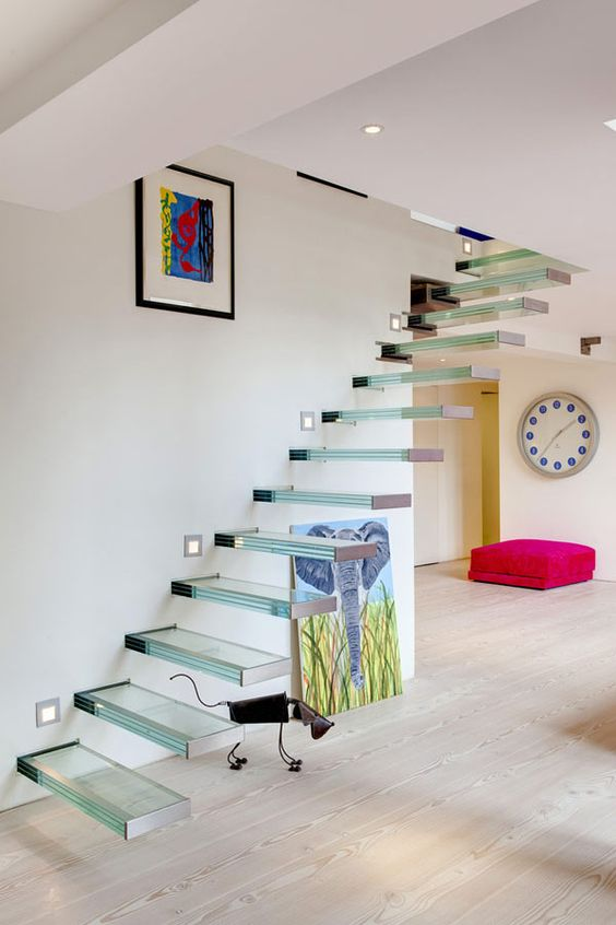 glass floating staircases look even more ethereal and airy than of any other material