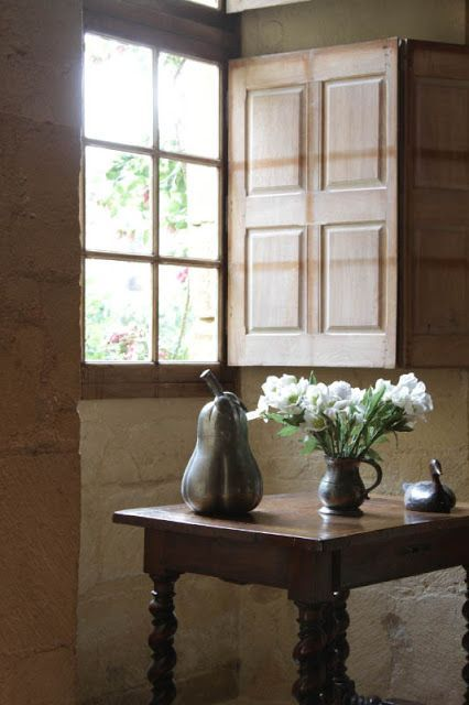 unlike curtains the shutters can fold completely and brign maximum of light inside plus they keep your space warm when closed