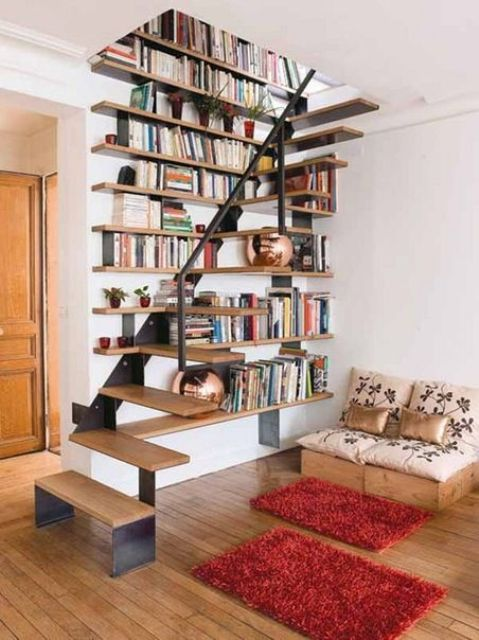 a floating metal and wood staircase integrated into the bookshelves on the wall