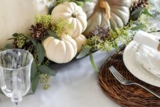 17 a natural fall centerpiece of a tray, seeded eucalyptus, heirloom pumpkins and pinecones for a rustic feel