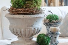 17 a vintage rustic centerpiece of moss and plastic pumpkins, vine and hay, add vintage books and voila, you have a nice decoration