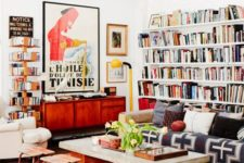 17 lots of books placed on the walls are great for maximalist spaces