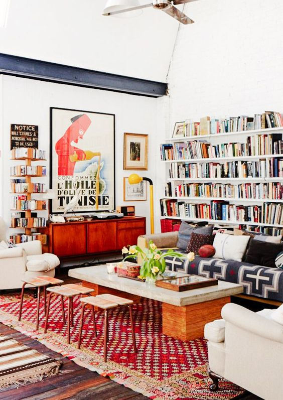 lots of books placed on the walls are great for maximalist spaces