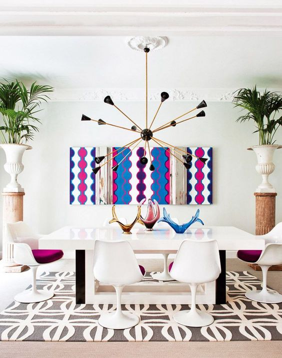a bold printed artwork makes a statement and a printed rug is a more neutral addition to the dining room