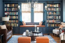 18 a colorful interior in blue and orange with lots of bookshelves that frame the window