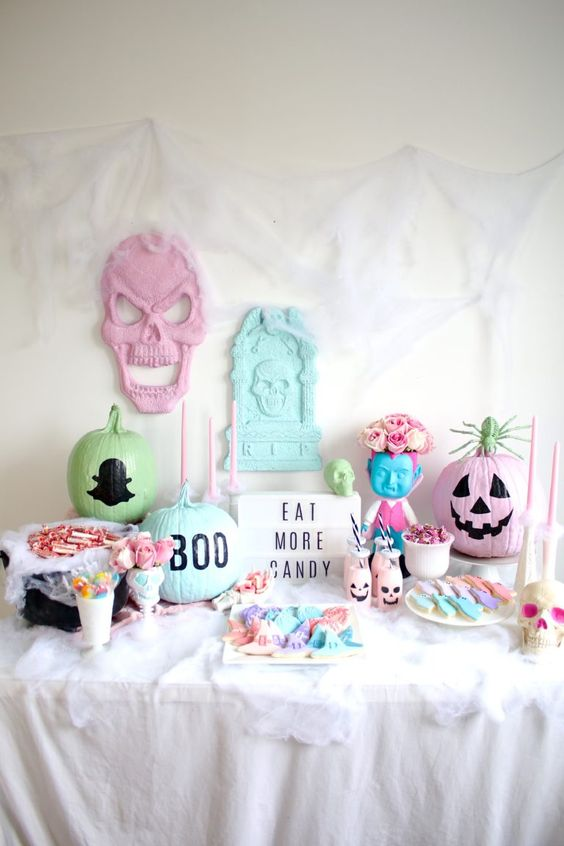 a pastel Halloween candy bar with painted pumpkins, skulls and ugly dolls