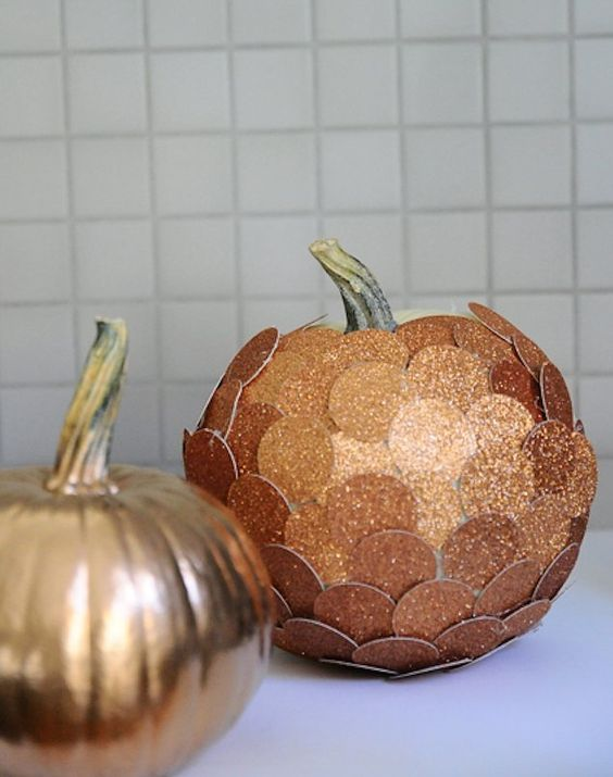 a spray paint copper pumpkin and a copper glitter penny pumpkin for the fall and Thanksgiving