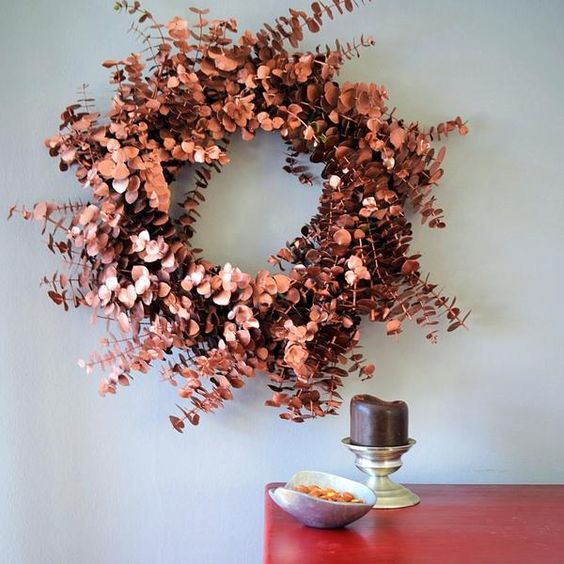 a copper eucalyptus wreath is a chic modern idea for fall and Thanksgiving and can be crafted easily
