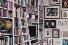 19 a large bookshelf unit that takes the whole wall is a great idea for a maximalist space, and artworks on the other wall help to show off the trend too