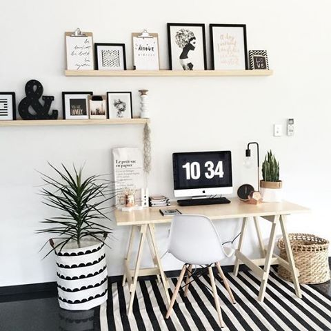 a monochrome striped rug and a simple secondary print on the wrap for the pot make the space bolder