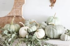 19 a neutral fall mantel with light green and white pumpkins plus seeded eucalyptus is great for Thanksgiving