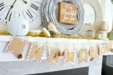 19 a simple banner of paper, painted pumpkins, a wreath and a framed mirror plus a fake bird