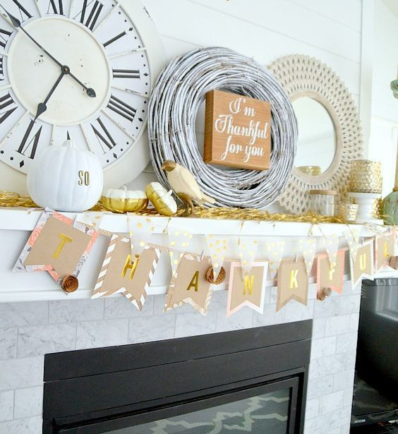 a simple banner of paper, painted pumpkins, a wreath and a framed mirror plus a fake bird