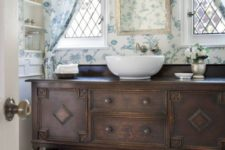 19 florals amd stripes beautifully mixed in bathroom decor and dark stained furniture for a contrast