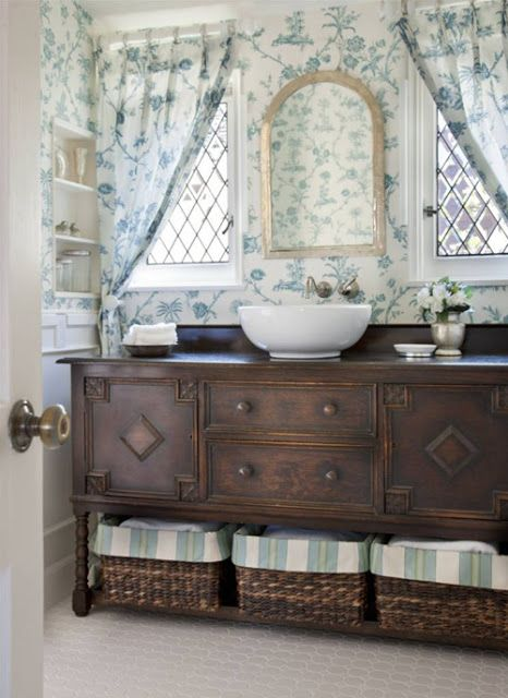 florals amd stripes beautifully mixed in bathroom decor and dark stained furniture for a contrast