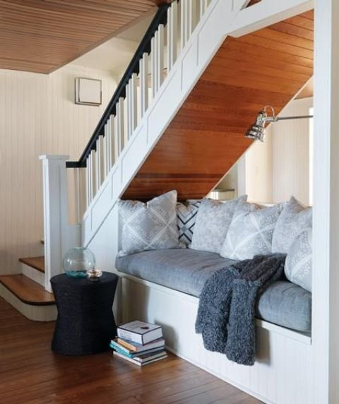 use the space under the stairs for an ultimate comfortable nook for reading or having a nap