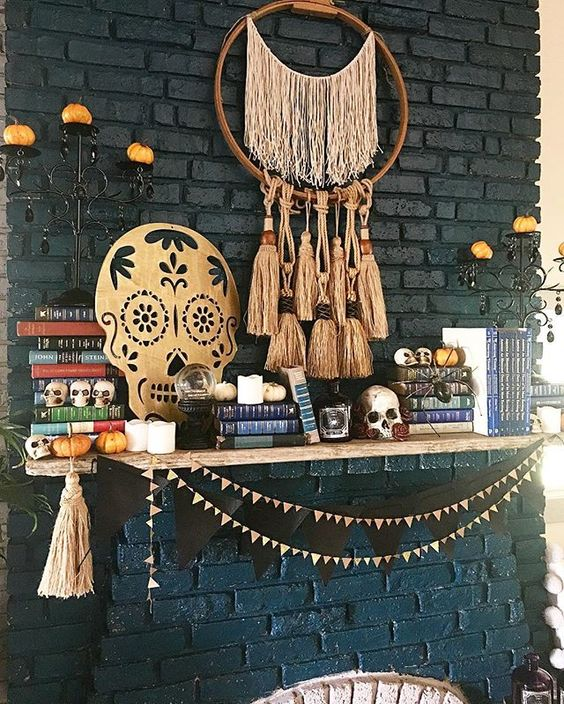 a cool mantel with a boho tassel dream catcher, a sugar skull artwork, a black bunting and some little skulls