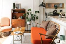 20 warm orange and coral are mixed with fresh greenery and calmed down with natural wood