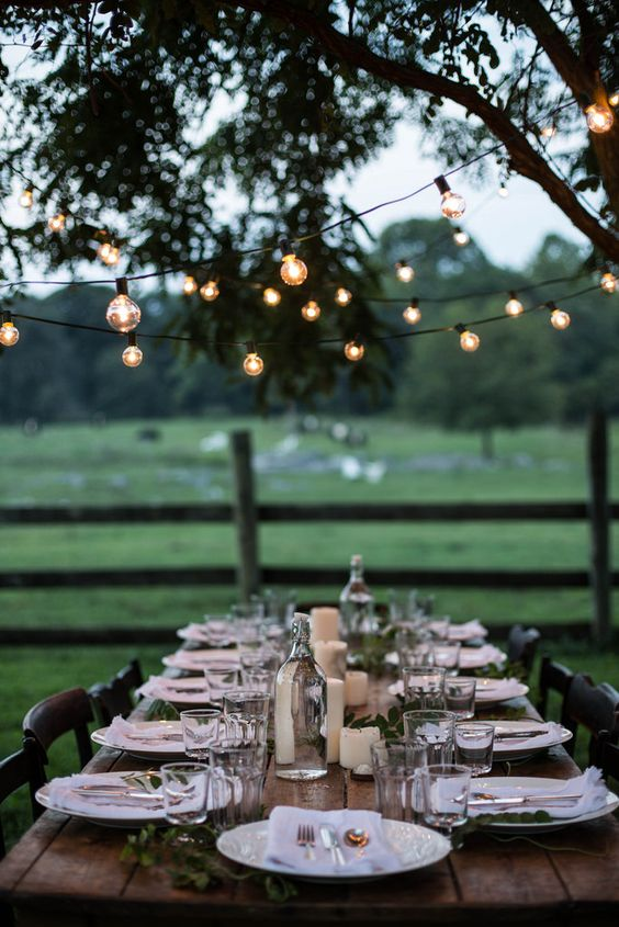 lights over the table setting make the space cozier and comfier and welcome people to join