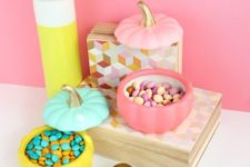 21 make some color block faux pumpkin candy dishes for your cool Halloween candy bar