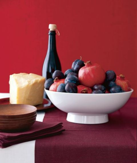 a simple bowl centerpiece with pomegranates and plums is a great last minute idea for Thanksgiving